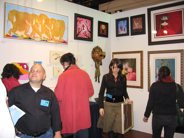 AAF  & nbsp -  <strong>the booth</strong> (<strong style = 'color:#635a27'></strong>)<bR /> Gathers at the booth. Artwork by Ben Woodward, Gary Baseman, AJ Fosik and Ray Caesar