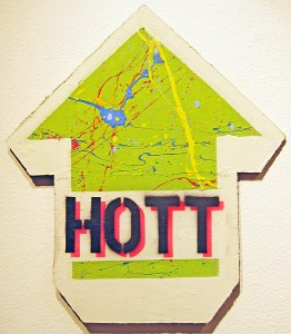 ABOVE   -  <strong>HOTT/SEXX (front view)</strong> (2010<strong style = 'color:#635a27'></strong>)<bR /> mixed media on panel,   18 x 16 inches  (45.72 x 40.64 cm)