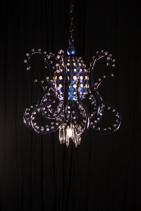 Adam  Wallacavage -  <strong>The Mortal Coil (Black Jellyfish)</strong> (2013<strong style = 'color:#635a27'></strong>)<bR /> wire, lamp parts, vintage glass, glass beads, epoxy resin, epoxy clay,   23 x 21 inches  (58.42 x 53.34)