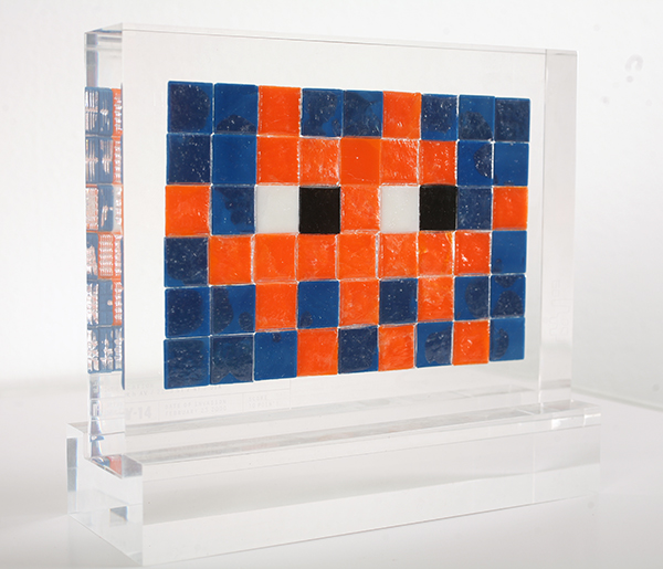 "Invader  &nbsp -  <strong>Alias NY_14</strong> (2009<strong style = 'color:#635a27'></strong>)<bR /> <font face=""Arial"">ceramic tiles in resin</font>,   <font face=""Arial"">6 1/2 x 8 1/2 x 2 inches, plus stand [16.5 x 21.6 x 5.1 cm]</font>,    ,   <font face=""Arial""><font face=""Arial"">Every Invader put up in the street can be reproduced as an Alias, which is a single replica of the original preserved in a transparent block of resin. The Alias also comes with an ID card that documents the location of the original piece. There is only one Alias produced per Invader.</font></font>,   <font face=""Arial"">NY_14 is the Alias of the Invader placed in February 2000. The price of each Alias is based on Invader's self-imposed ""score"" for difficulty and size. NY_14 is 10 points.</font>,    ,   <font face=""Arial"">"