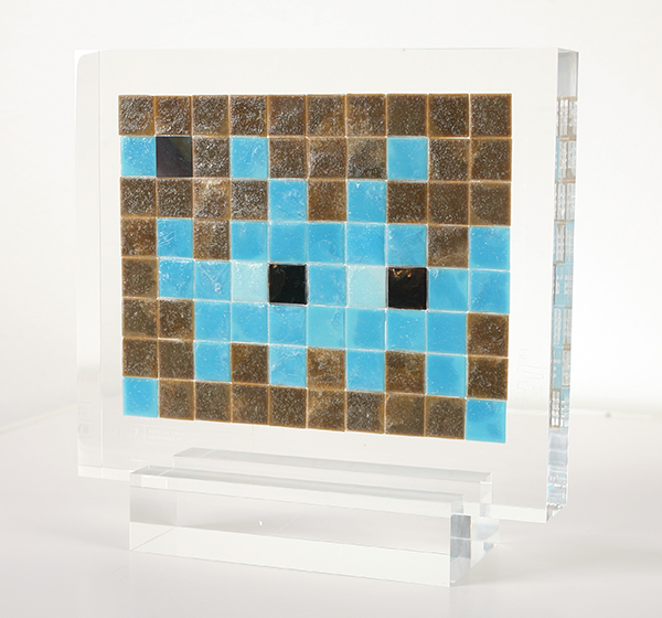 "Invader  &nbsp -  <strong>Alias NY_17</strong> (2009<strong style = 'color:#635a27'></strong>)<bR /> <font face=""Arial"">ceramic tiles in resin</font>,   <font face=""Arial"">8 1/4 x 9 1/2 x 2 inches, plus stand [21 x 24.1 x 5.1 cm]</font>,    ,   <font face=""Arial""><font face=""Arial"">Every Invader put up in the street can be reproduced as an Alias, which is a single replica of the original preserved in a transparent block of resin. The Alias also comes with an ID card that documents the location of the original piece. There is only one Alias produced per Invader.</font></font>,   <font face=""Arial"">NY_17 is the Alias of the Invader placed in February 2000. The price of each Alias is based on Invader's self-imposed ""score"" for difficulty and size. NY_17 is 20 points.</font>,    ,   <font face=""Arial"">"