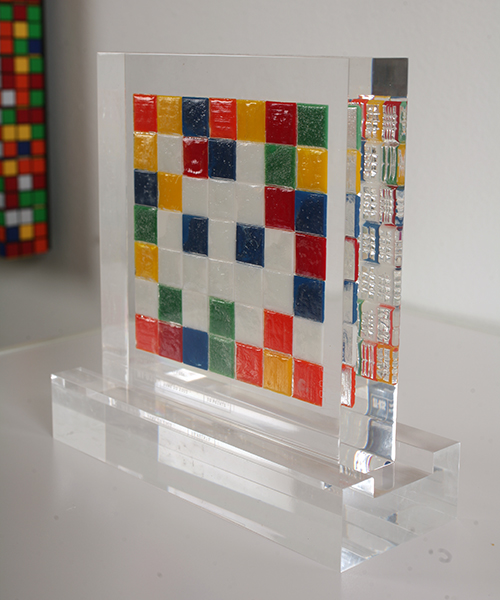 "Invader  &nbsp -  <strong>Alias NY_35</strong> (2009<strong style = 'color:#635a27'></strong>)<bR /> <font face=""Arial"">ceramic tiles in resin</font>,   <font face=""Arial"">7 1/2 x 7 x 2 inches, plus stand [19.1 x 17.8 x 5.1 cm]</font>,    ,   <font face=""Arial""><font face=""Arial"">Every Invader put up in the street can be reproduced as an Alias, which is a single replica of the original preserved in a transparent block of resin. The Alias also comes with an ID card that documents the location of the original piece. There is only one Alias produced per Invader.</font></font>,   <font face=""Arial"">NY_35 is the Alias of the Invader placed in June 2003. The price of each Alias is based on Invader's self-imposed ""score"" for difficulty and size. NY_35 is 10 points.</font>,    ,   <font face=""Arial"">"