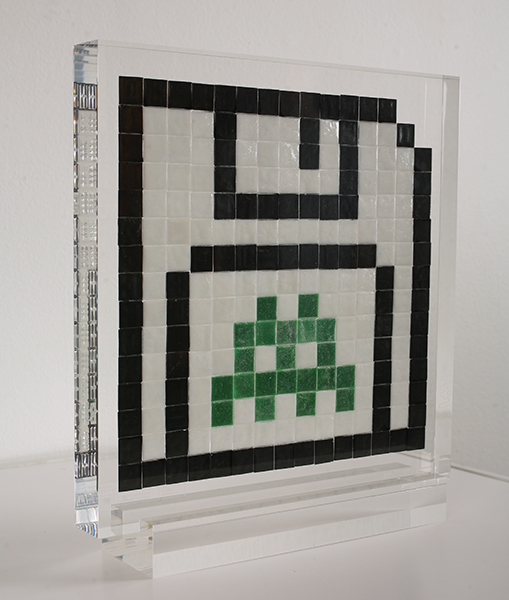 "Invader  &nbsp -  <strong>Alias NY_89</strong> (2009<strong style = 'color:#635a27'></strong>)<bR /> <font face=""Arial"">ceramic tiles in resin</font>,   <font face=""Arial"">11 x 11 x 2 inches, plus stand [27.9 x 27.9 x 5.1 cm]</font>,    ,   <font face=""Arial""><font face=""Arial"">Every Invader put up in the street can be reproduced as an Alias, which is a single replica of the original preserved in a transparent block of resin. The Alias also comes with an ID card that documents the location of the original piece. There is only one Alias produced per Invader.</font></font>,   <font face=""Arial"">NY_89 is the Alias of the Invader placed in November 2007. The price of each Alias is based on Invader's self-imposed ""score"" for difficulty and size. NY_89 is 20 points.</font>,    ,   <font face=""Arial"">"