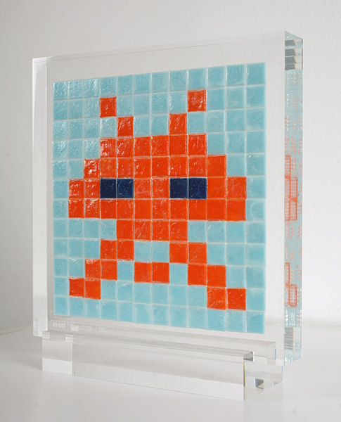 "Invader  &nbsp -  <strong>Alias NY_97</strong> (2009<strong style = 'color:#635a27'></strong>)<bR /> <font face=""Arial"">ceramic tiles in resin</font>,   <font face=""Arial"">8 1/4 x 9 1/2 x 2 inches, plus stand [21.6 x 24.1 x 5.1 cm]</font>,    ,   <font face=""Arial""><font face=""Arial"">Every Invader put up in the street can be reproduced as an Alias, which is a single replica of the original preserved in a transparent block of resin. The Alias also comes with an ID card that documents the location of the original piece. There is only one Alias produced per Invader.</font></font>,   <font face=""Arial"">NY_97 is the Alias of the Invader placed in December 2007. The price of each Alias is based on Invader's self-imposed ""score"" for difficulty and size. NY_97 is 10 points.</font>,    ,   <font face=""Arial"">"