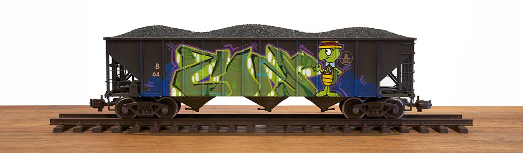 Tim  Conlon -  <strong>B & O #2</strong> (2014<strong style = 'color:#635a27'></strong>)<bR /> spray paint and paint marker on model train car,   6 x 19 x 5 inches  (15.24 x 48.26 x 12.70 cm)