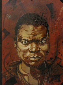 C215 -  <strong>Untitled (Boy Face)</strong> (2013<strong style = 'color:#635a27'></strong>)<bR /> spraypaint on panel 28 1/4 x 20 1/2 in.