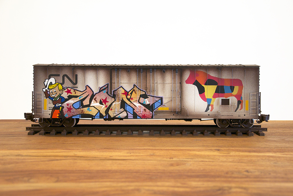 Tim  Conlon -  <strong>CN #11</strong> (2014<strong style = 'color:#635a27'></strong>)<bR /> spray paint and paint marker on model train car,   7 x 24 x 5 inches  (17.78 x 60.96 x 12.70 cm)