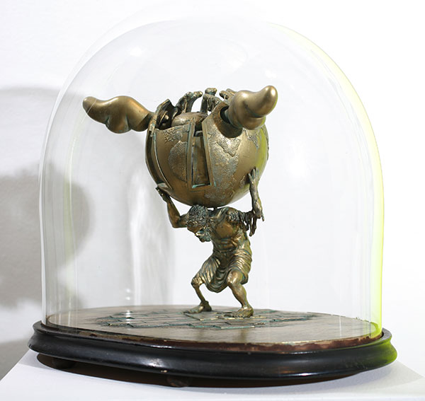 D*Face  &nbsp -  <strong>Worlds End</strong> (2009<strong style = 'color:#635a27'></strong>)<bR /> resin maquette with hand painted patina in a Victorian, taxidermy display case,   10 x 9 x 5 inches [25.4 x 22.9 x 12.7 cm]