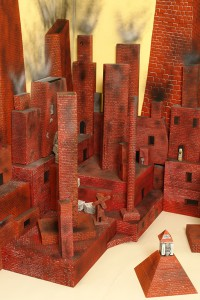 Andrew  Schoultz -  <strong>Installation detail</strong> (2006<strong style = 'color:#635a27'></strong>)<bR /> Mixed media with hand sculpted buildings and figures,   Dimensions variable