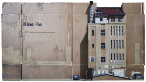 EVOL   -  <strong>Großes Kino (HPM, Charlottenstr Version #3)</strong> (2012<strong style = 'color:#635a27'></strong>)<bR /> spray paint on cardboard,   34.84 x 63.38 inches (88.5 x 161 cm)  40.125 x 67.75 x 3.5 inches, framed