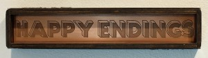 Faile   -  <strong>Happy Endings Copper</strong> (2014<strong style = 'color:#635a27'></strong>)<bR /> copper plate and silkscreen ink on wood, steel frame,   4 x 20 x 3 inches  (10.16 x 50.80 x 7.62 cm)