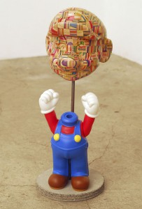 Haroshi   -  <strong>3D Mario</strong> (2009<strong style = 'color:#635a27'></strong>)<bR /> used skateboards and vinyl,   17.72 x 5.12 x 4.72 inches  (45 x 13 x 12 cm)