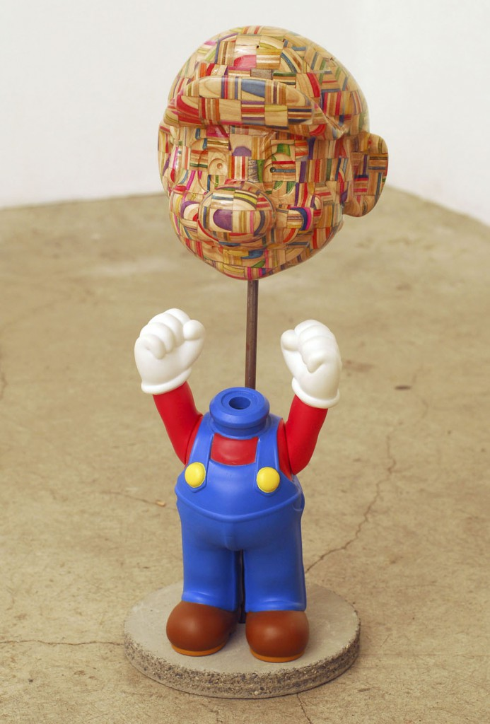 Haroshi  &nbsp -  <strong>3D Mario</strong> (2009<strong style = 'color:#635a27'></strong>)<bR /> used skateboards and vinyl,   17.72 x 5.12 x 4.72 inches  (45 x 13 x 12 cm)