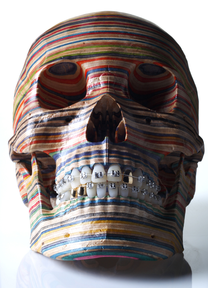 Haroshi  &nbsp -  <strong>Skull</strong> (2012<strong style = 'color:#635a27'></strong>)<bR /> used skateboards, wheels, dental braces and 18-karat gold teeth,   8.66 x 5.12 x 6.69 inches  (22 x 13 x 17 cm)