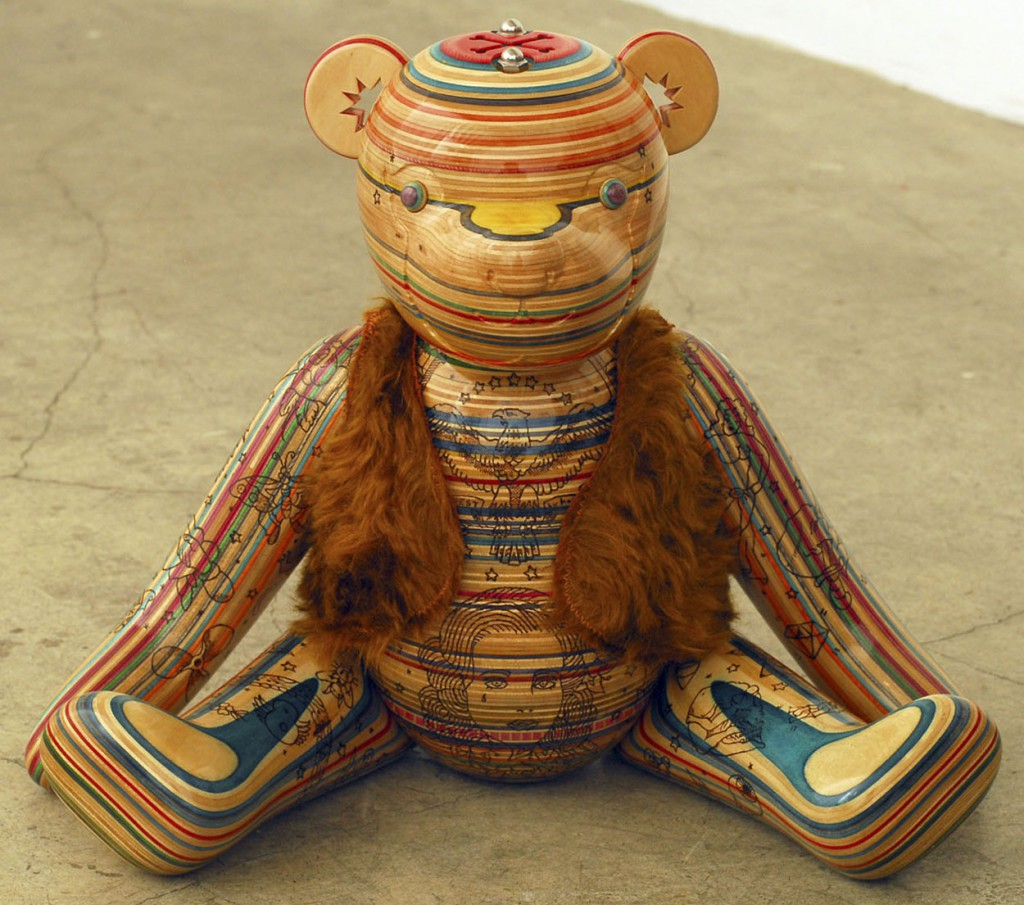 Haroshi  &nbsp -  <strong>Tattooed Teddy Bear</strong> (2011<strong style = 'color:#635a27'></strong>)<bR /> used skateboards and fabric,   11.81 x 12.99 x 12.99 inches  (30 x 33 x 33 cm)