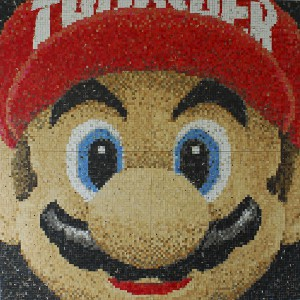 Haroshi  &nbsp -  <strong>Thrasher Mario</strong> (2009<strong style = 'color:#635a27'></strong>)<bR /> used skateboards,   59 x 59 x 2.75 inches (150 x 150 x 7 cm)  29.5 x 29.5 x .75 inches, each panel