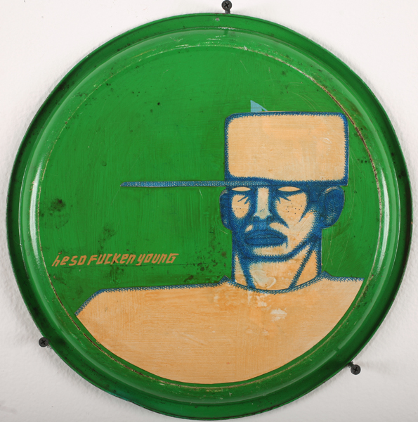 Date Farmers  &nbsp -  <strong>He so Fucken Young</strong> (2010<strong style = 'color:#635a27'></strong>)<bR /> mixed media on found metal tray,   13 x 13 inches  (33.02 x 33.02 cm)