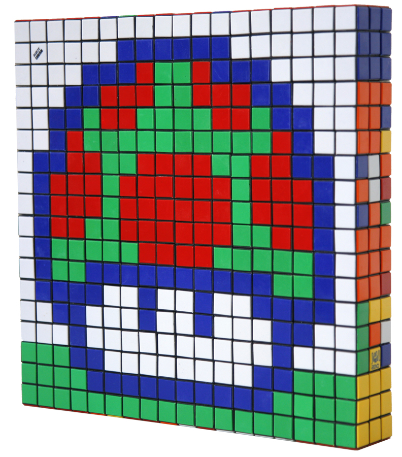 Invader  &nbsp -  <strong>Eat Me (1)</strong> (2010<strong style = 'color:#635a27'></strong>)<bR /> 36 Rubik's cubes,   12.75 x 12.75 x 2.25 inches  (32.39 x 32.39 x 5.72 cm)