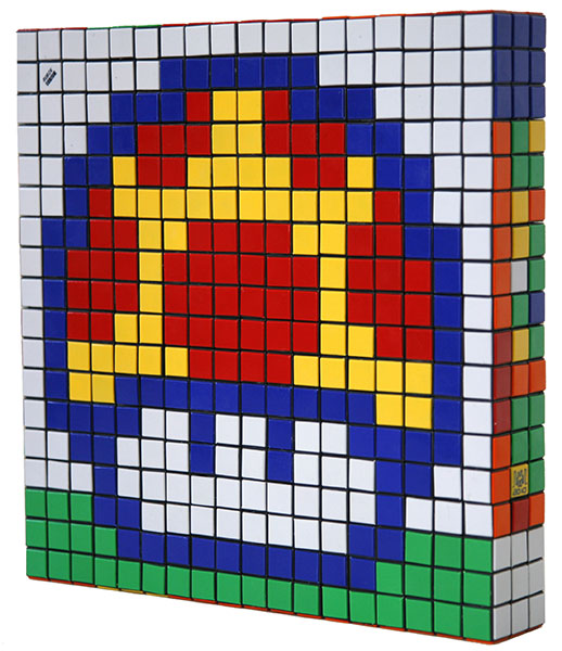 Invader  &nbsp -  <strong>Eat Me (2)</strong> (2010<strong style = 'color:#635a27'></strong>)<bR /> 36 Rubik's cubes,   12.75 x 12.75 x 2.25 inches  (32.39 x 32.39 x 5.72 cm)