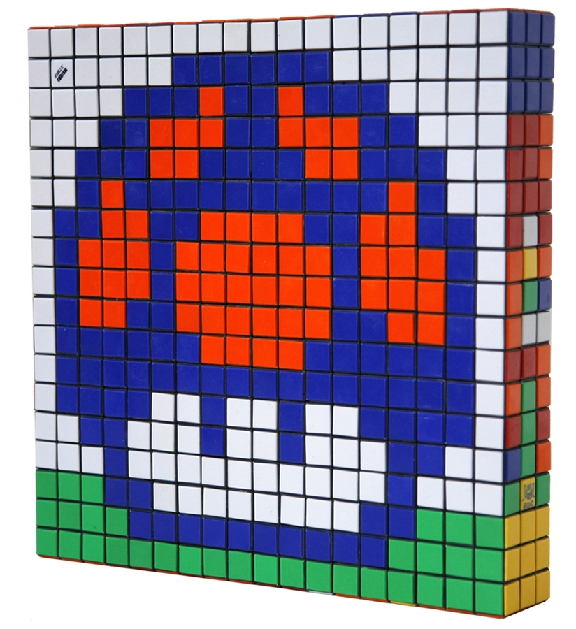 Invader  &nbsp -  <strong>Eat Me (3)</strong> (2010<strong style = 'color:#635a27'></strong>)<bR /> 36 Rubik's cubes,   12.75 x 12.75 x 2.25 inches  (32.39 x 32.39 x 5.72 cm)