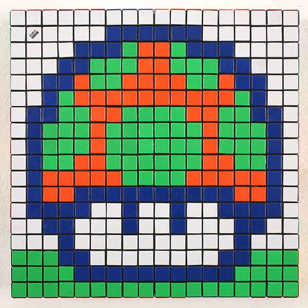 Invader  &nbsp -  <strong>Eat Me (5)</strong> (2010<strong style = 'color:#635a27'></strong>)<bR /> 36 Rubik's cubes,   12.75 x 12.75 x 2.25 inches  (32.39 x 32.39 x 5.72 cm)