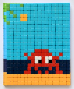 Invader    -  <strong>Mission Miami Mosaic Cover 12</strong> (2012<strong style = 'color:#635a27'></strong>)<bR /> 414 micro mosaic tiles on hardcover book in custom plexiglass case,   9.25 x 7.625 inches  (23.5 x 19.37 cm)