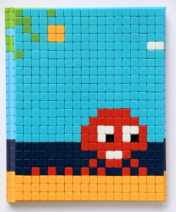 Invader    -  <strong>Mission Miami Mosaic Cover 15</strong> (2012<strong style = 'color:#635a27'></strong>)<bR /> 414 micro mosaic tiles on hardcover book in custom plexiglass case,   9.25 x 7.625 inches  (23.5 x 19.37 cm)