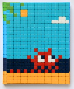 Invader    -  <strong>Mission Miami Mosaic Cover 17</strong> (2012<strong style = 'color:#635a27'></strong>)<bR /> 414 micro mosaic tiles on hardcover book in custom plexiglass case,   9.25 x 7.625 inches  (23.5 x 19.37 cm)