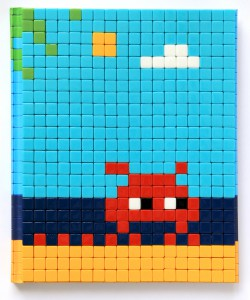 Invader    -  <strong>Mission Miami Mosaic Cover 20</strong> (2012<strong style = 'color:#635a27'></strong>)<bR /> 414 micro mosaic tiles on hardcover book in custom plexiglass case,   9.25 x 7.625 inches  (23.5 x 19.37 cm)