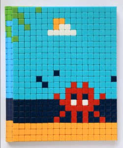 Invader   -  <strong>Mission Miami Mosaic Cover 25</strong> (2012<strong style = 'color:#635a27'></strong>)<bR /> 414 micro mosaic tiles on hardcover book in custom plexiglass case,   9.25 x 7.625 inches  (23.5 x 19.37 cm)