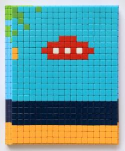 Invader   -  <strong>Mission Miami Mosaic Cover 3</strong> (2012<strong style = 'color:#635a27'></strong>)<bR /> 414 micro mosaic tiles on hardcover book in custom plexiglass case,   9.25 x 7.625 inches  (23.5 x 19.37 cm)