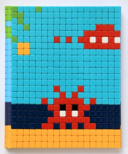 Invader    -  <strong>Mission Miami Mosaic Cover 5</strong> (2012<strong style = 'color:#635a27'></strong>)<bR /> 414 micro mosaic tiles on hardcover book in custom plexiglass case,   9.25 x 7.625 inches  (23.5 x 19.37 cm)