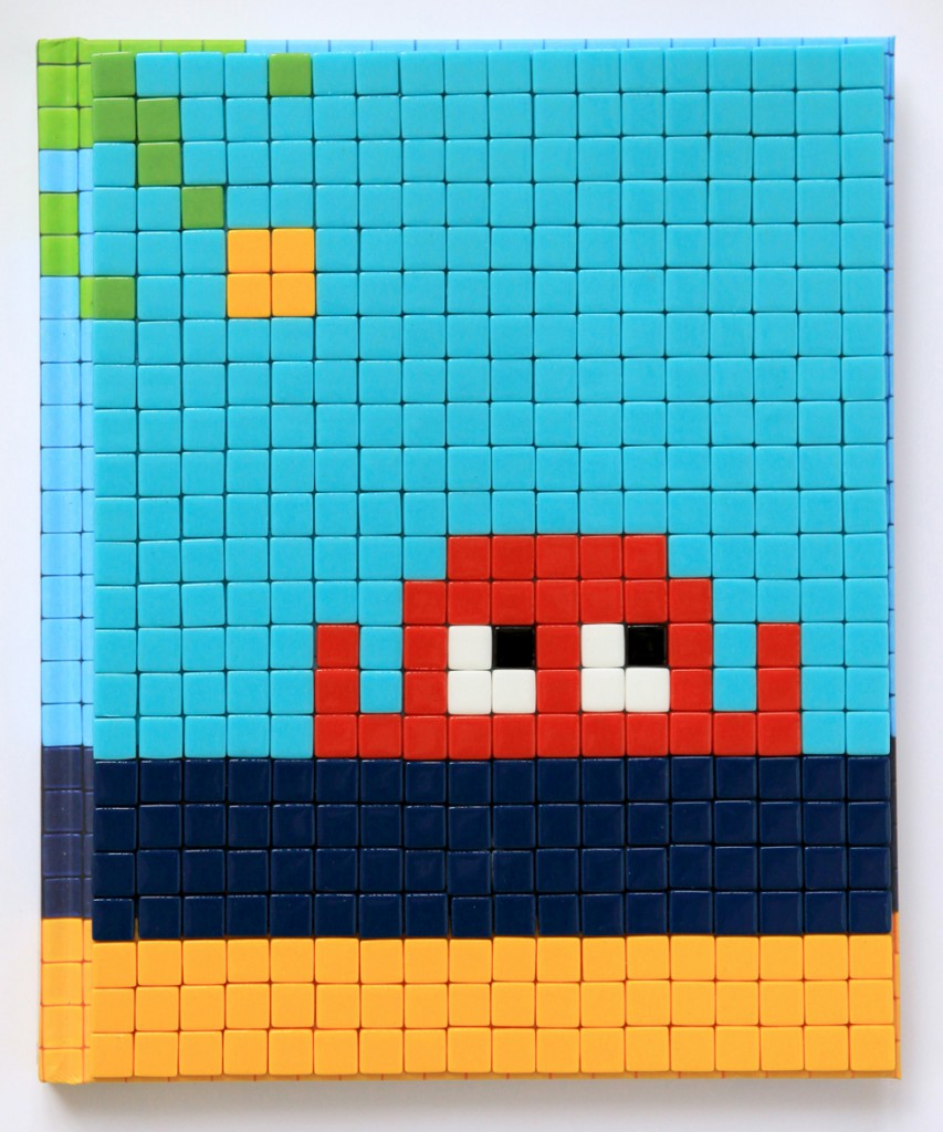 Invader  &nbsp -  <strong>Mission Miami Mosaic Cover 9</strong> (2012<strong style = 'color:#635a27'></strong>)<bR /> 414 micro mosaic tiles on hardcover book in custom plexiglass case,   9.25 x 7.625 inches  (23.5 x 19.37 cm)