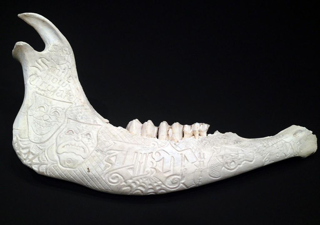 Jesse  Hazelip -  <strong>Lady From Bristol</strong> (2013<strong style = 'color:#635a27'></strong>)<bR /> carved bull jaw bone,   2 x 15 x 10 inches  (5.08 x 38.1 x 25.4 cm)