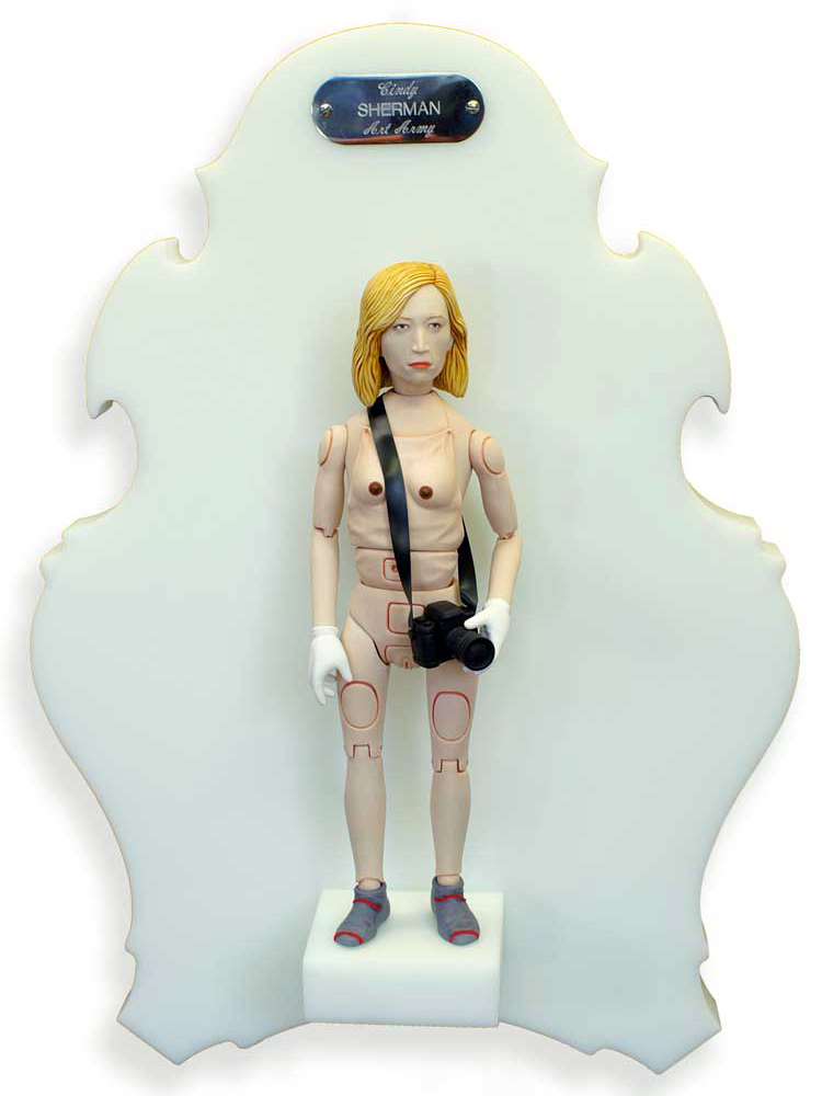 Michael  Leavitt -  <strong>Cindy Sherman</strong> (2011<strong style = 'color:#635a27'></strong>)<bR /> polymer clay and mixed media,   11 x 3 x 2 inches, unframed  18 x 12 x 6 inches, framed