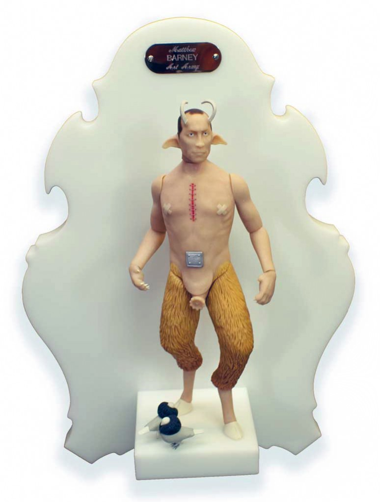 Michael  Leavitt -  <strong>Matthew Barney</strong> (2011<strong style = 'color:#635a27'></strong>)<bR /> polymer clay and mixed media,   11 x 4 x 2 inches, unframed  18 x 12 x 6 inches, framed