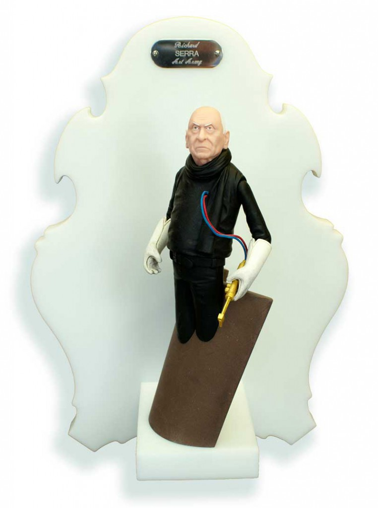 Michael  Leavitt -  <strong>Richard Serra</strong> (2011<strong style = 'color:#635a27'></strong>)<bR /> polymer clay and mixed media,   11 x 4 x 5 inches, unframed  18 x 12 x 6 inches, framed