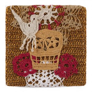 Olek    -  <strong>Crocheted Skull with Bird No. 01</strong> (2013<strong style = 'color:#635a27'></strong>)<bR /> crocheted acrylic yarn and metallic ribbon on metallic fabric,   9.25 x 9.25 inches  (23.50 x 23.50 cm)