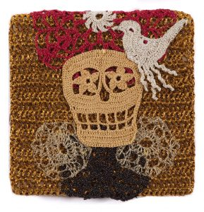 Olek    -  <strong>Crocheted Skull with Bird No. 04</strong> (2013<strong style = 'color:#635a27'></strong>)<bR /> crocheted acrylic yarn and metallic ribbon on metallic fabric,   9.25 x 9.25 inches  (23.50 x 23.50 cm)