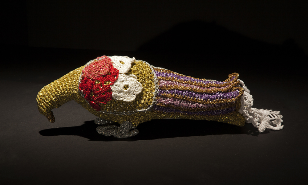Olek  &nbsp -  <strong>Crocheted Flying Rat No. 01</strong> (2013<strong style = 'color:#635a27'></strong>)<bR /> crocheted acrylic yarn and metallic ribbon on plastic bird,   5.25 x 17 x 4.5 inches  (13.34 x 43.18 x 11.43 cm)