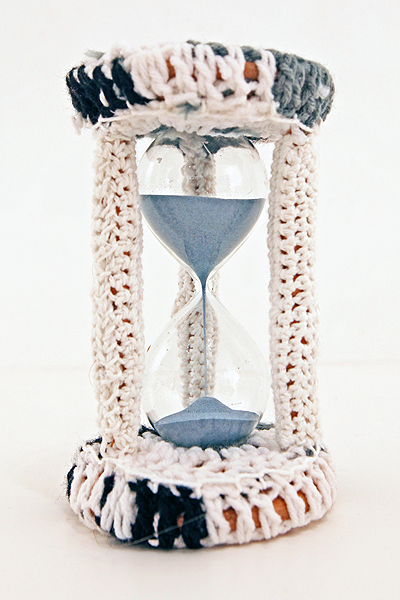 Olek  &nbsp -  <strong>Crocheted Hourglass</strong> (2011<strong style = 'color:#635a27'></strong>)<bR /> mixed media,   7.5 x 4.5 x 4.25 inches  (19 x 11.43 x 10.67 cm)