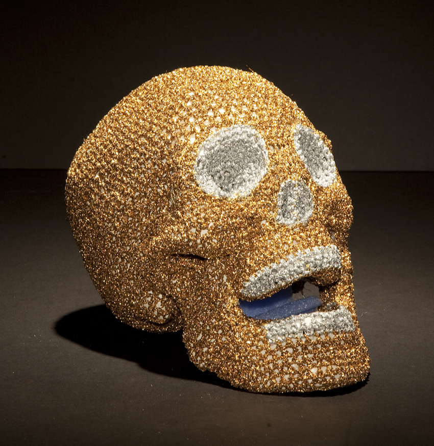 Olek  &nbsp -  <strong>Ex-boyfriend No. 01</strong> (2013<strong style = 'color:#635a27'></strong>)<bR /> crocheted acrylic yarn and metallic ribbon on plastic skull,   6.25 x 5.75 x 8.5 inches  (15.87 x 14.6 x 21.6 cm)