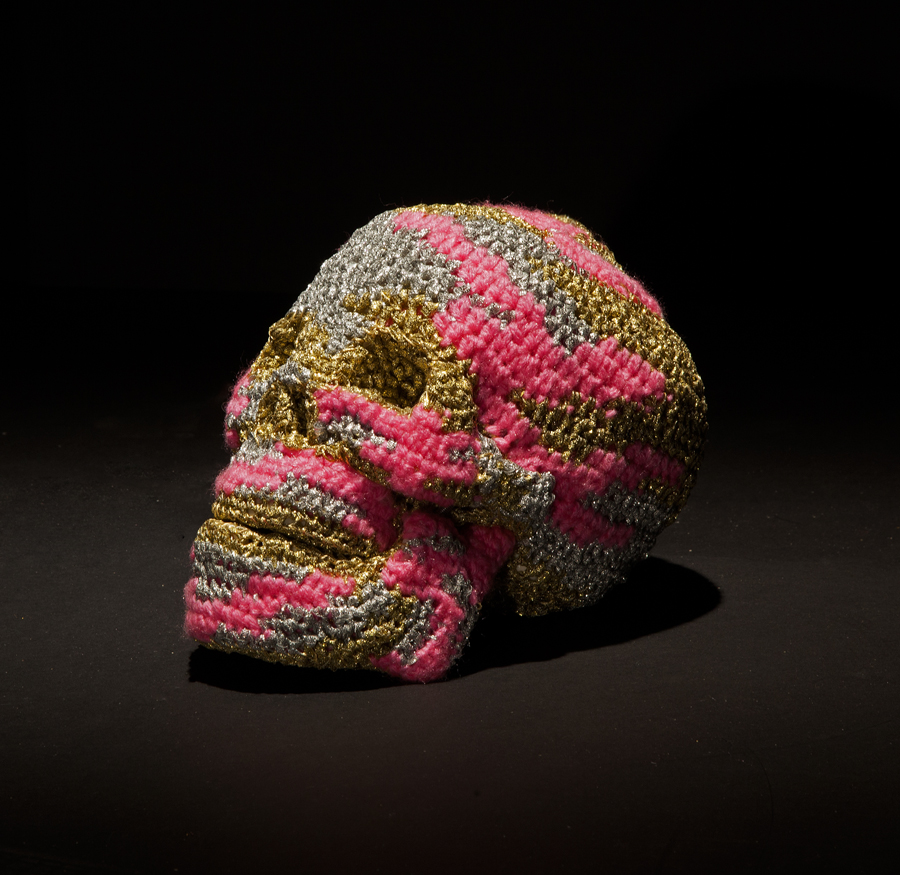 Olek  &nbsp -  <strong>Ex-boyfriend No. 02</strong> (2013<strong style = 'color:#635a27'></strong>)<bR /> crocheted acrylic yarn and metallic ribbon on plastic skull,   6.25 x 5.75 x 8.5 inches  (15.87 x 14.6 x 21.6 cm)