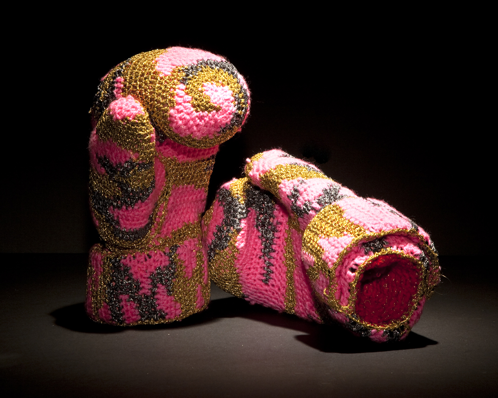 Olek  &nbsp -  <strong>Fight No. 01</strong> (2013<strong style = 'color:#635a27'></strong>)<bR /> crocheted acrylic yarn and metallic ribbon on boxing gloves,   12 x 7 x 6.25 inches, each  (30.48 x 17.78 x 15.87 cm), each