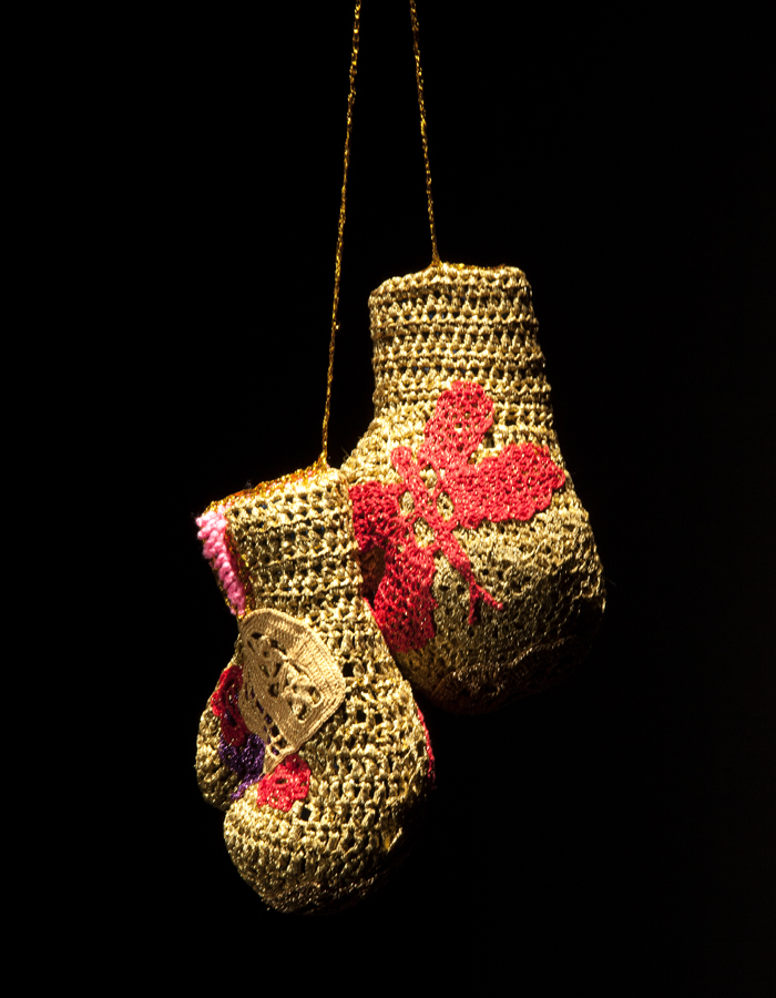 Olek  &nbsp -  <strong>Fight No. 02</strong> (2013<strong style = 'color:#635a27'></strong>)<bR /> crocheted acrylic yarn and metallic ribbon on boxing gloves,   11 x 8 x 5 inches, each  (28.26 x 20.32 x 12.7 cm), each