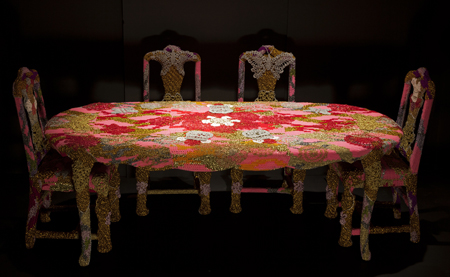 Olek  &nbsp -  <strong>The End of Any Event</strong> (2013<strong style = 'color:#635a27'></strong>)<bR /> crocheted acrylic yarn and metallic ribbon on dining table and chairs,   table: 29.5 x 84 x 40 inches  chairs: 42.5 x 15.75 x 17.5 inches, each