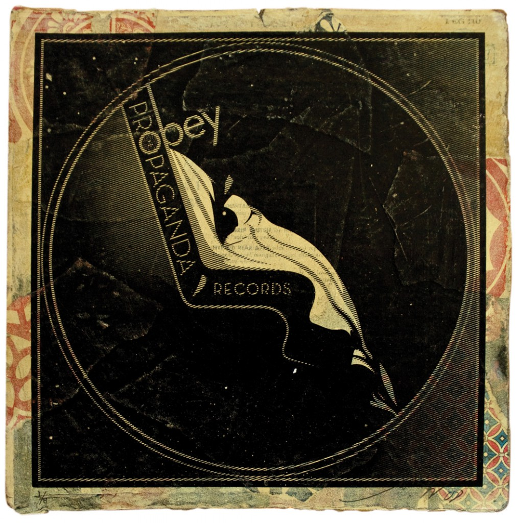 Shepard  Fairey -  <strong>Perfect Kiss</strong> (2011<strong style = 'color:#635a27'></strong>)<bR /> Silkscreen and mixed media collage on album cover,   12 x 12 inches  (framed size TBD),   Hand painted multiple (HPM)  Signed and numbered   Edition of 8
