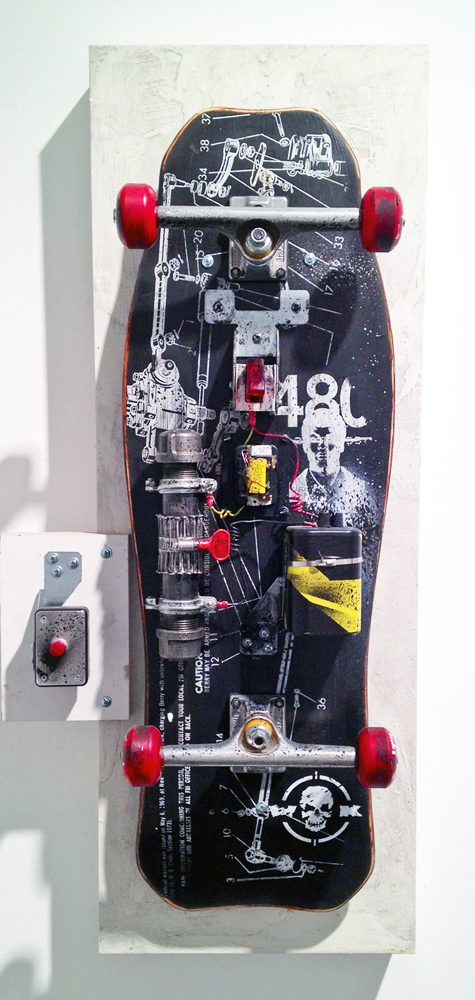 WK  &nbsp -  <strong>Blow Yourself Up - 2</strong> (<strong style = 'color:#635a27'></strong>)<bR /> mixed media on skateboard on panel,   36 x 17 x 9 inches  (91.44 x 43.18 x 22.86 cm)