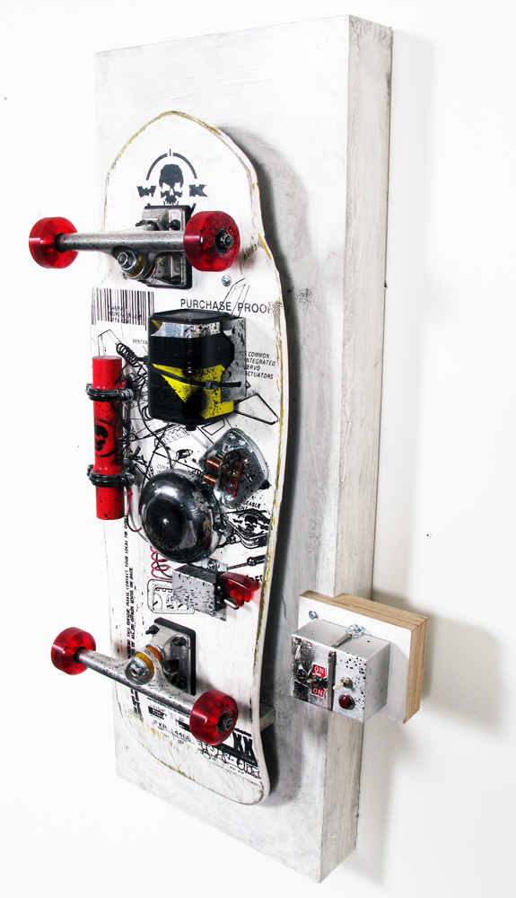 WK  &nbsp -  <strong>Blow Yourself Up - 3</strong> (<strong style = 'color:#635a27'></strong>)<bR /> mixed media on skateboard on panel,   36 x 17 x 8.5 inches  (91.44 x 43.18 x  21.59 cm)