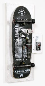WK    -  <strong>Blow Yourself Up - 2</strong> (<strong style = 'color:#635a27'></strong>)<bR /> mixed media on skateboard on panel,   36 x 17 x 9 inches  (91.44 x 43.18 x 22.86 cm)